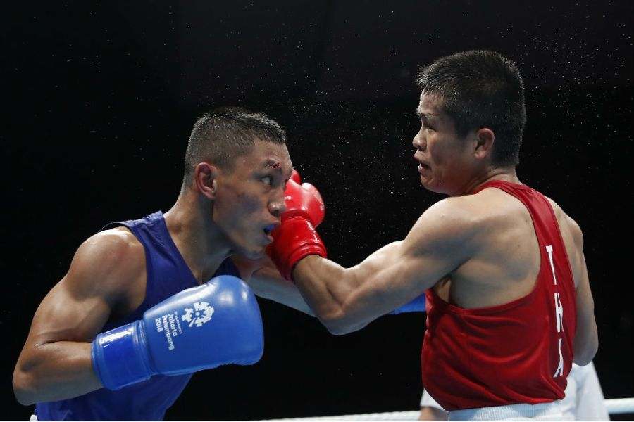 Asian Games  Pinoy boxer Rogen Ladon advances to gold medal match     Rogen Ladon  left  beat Tongdee Yuttapong of Thailand to advance to the  gold medal match in the flyweight division of the boxing competition in the  2018