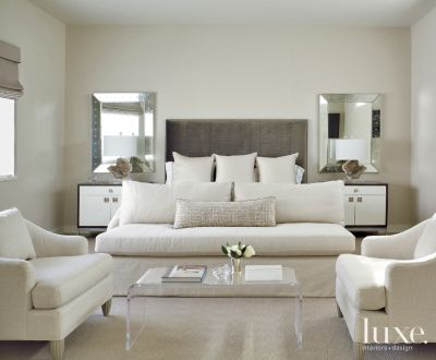 Neutral Modern Master Bedroom With Vintage Coffee Table