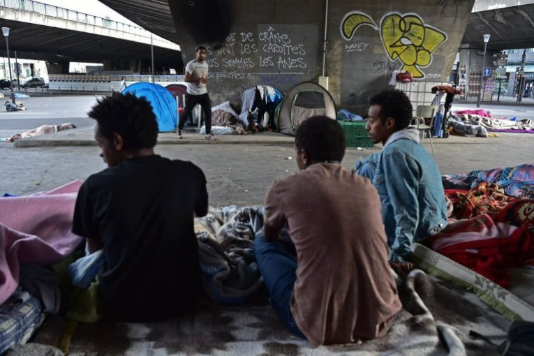 Evicted Paris migrants transferred to temporary shelters   InfoMigrants migrants at porte de la Chapelle in Paris in June 2017   Photo  Christophe  Archambault