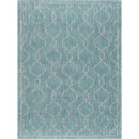 Whether you're getting a fashionable foundation for your well-curated and welcoming entertainment space or complementing a transitional aesthetic on the back patio, this striking area rug is sure to draw the eye in your abode. Featuring a bold geometric trellis motif awash in a cool aqua palette, this rug sets the perfect anchor for earthy wood tables and light linen upholstery, while its power-loomed polypropylene design makes it a natural stain- and water-resistant addition to spaces inside...