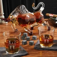 Looking for something truly unique for your home bar that no one else you know will have? You've found it. This way too cool custom liquor decanter set is equal parts classy and eye-catching. Included are a beautifully detailed bull decanter, two rocks glasses, and a set of nine whiskey stones. The two glasses are personalized with an initial and name of your choosing. This set belongs as the centerpiece of your home bar or in a prominent place in the office so that everyone who visits will see...