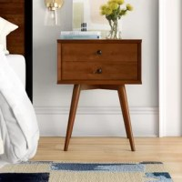 Combining functionality with mid-century modern style, this nightstand's sleek lines and storage spaces are sure to please. Crafted from solid pine wood, this design stands atop splayed legs for a contemporary twist on a retro look, while the streamlined body features a pair of drawers on roller glides – perfect for tucking away small-scale accents in the master suite. It's designed to fit right next to the bedside.
