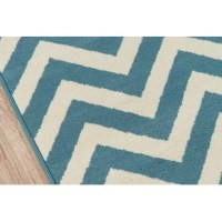 Lend a pop of pattern to your patio with this eye-catching area rug! Made in Egypt, it is power-loomed from polypropylene with a low pile height for a weather-resistant design that doesn't mind UV light beaming down or rainstorms rolling through. Plus, it pops no matter where you place it thanks to a chic chevron motif in hues of blue and cream. To keep this piece safely in place, we recommend using a rug pad.
