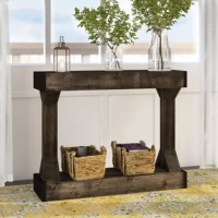 This Dexter Console Table is full of character with the real wood design. Made to tie in with your unique style easily, this table is the perfect stage for your photos and decor. Dress it up or dress it down, the tones and clean lines make for a great centerpiece in your living room, dining room, or entryway. This table comes fully assembled and ready to decorate.
