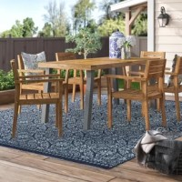 This complete wood dining set is the perfect solution to your outdoor dining search. Complete with six acacia wood chairs that pair beautifully with the matching acacia wood table, this set is sure to shine on your patio. Enjoy hosting again and through the best BBQs, the neighborhood has ever seen with this top-quality dining set.