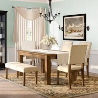 Bring bold presence to your dining room décor with this stylish dining set. The dining table showcases a rectangular table top with decorative stone inserts, sure to lend a natural feel to any dining space. The table top rests upon sturdy block legs. The dining chair showcases a padded seat and back, expertly upholstered in Ivory flax fabric with nailhead trim. The dining bench features the same padded flax fabric seat and sturdy wooden construction. The wooden legs are finished in natural...