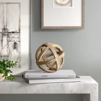 Whether you're looking to round out a display with an eye-catching touch, or add a dash of design to your shelves, a sculpture like this is a great option for lending your home a versatile accent. Crafted from wood with a natural finish, this piece features joined circles for a look that evokes the bands of an astrolabe. This piece is perfectly proportioned to round out a dining table centerpiece, or grab glances on your coffee table.
