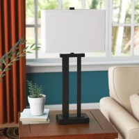 This table lamp lights up your design world. Metal base with an open silhouette creates engaging negative space. A linear profile is just what you've been craving.