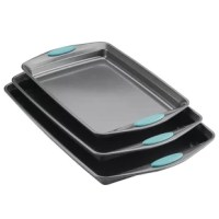 Offering three popular-sized nonstick baking pans, the Cookie Pan Set is ideal for making both savory and sweet treats. These cookie pans are made from durable steel that resists warping and feature long-lasting nonstick that provides excellent food release and easy cleanup. With a small, medium, and a large cookie sheet, enjoy the convenience of three sizes to do everything from using the set as roasting pans, broiling cheesy garlic bread, or baking Rachael's Ranch-Style Potato Skins and...
