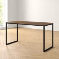 Defined by its clean lines and mixed materials, this understated dining table is an ideal anchor for modern space with a touch of rustic influence. Founded atop a tubular sled-style steel base finished in black, its manufactured wood top sports a contrasting brown finish for a hint of warmth. This design measures 55'' L x 24'' W x 29'' H overall to comfortably seat four, making it the perfect pick for a smaller space. Assembly is required.