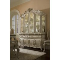 The influence of French regal comes to life with this unique collection. A classic French look with a chic twist depicting a hip, couture feel. Traditional carvings are highlighted with a glazed silver metallic tipping. Genuine Swarovski crystals accent door glass, mirrors and hardware.