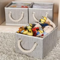 Keep clutter under control in style with this three-piece set of fabric basket storage bins! Founded on a heavy-duty cardboard frame, each basket strikes a clean-lined rectangular silhouette wrapped in textured polyester fabric. Its open top makes it easy to stow away magazines, toys, folded blankets, and more, while chunky braided rope handles in metal grommets make transport a breeze. Plus, they're perfectly sized to fit in cube units and storage cubbies.