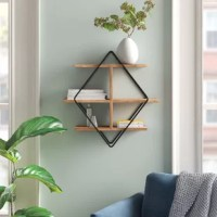 Whether you're putting small succulents on display or creating a space to show off framed photos, this handy wall shelf is an eye-catching focal point in any room. A contemporary and industrial design made in India, it pairs a double diamond iron frame with three mango wood shelves for a touch of contrast. Arriving at you ready to hang, it provides a decorative and functional space for your home office, living room, or kitchen. Plus, it comes with wall mounting hardware, saving you a trip to...