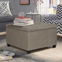Featuring a generously padded top with handcrafted diamond tufting, This tufted Ottoman injects comfort and style to any space. Elegant velvet polyester fabric upholstery plus elegantly turned, contrasting wood legs complete its charming design.