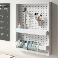 Keep your craft supplies in easy reach and at eye-level with a handy pegboard like this one! This wall-mounted panel is designed to allow you to pin your most-used tools and supplies to the board where you can easily find them and is crafted from manufactured wood with a neutral white finish that's easily mixed into your current color palette. Plus, it includes two versatile metal trays with removable rods allow you to easily stow ribbons, spools of thread, and other smaller crafts.
