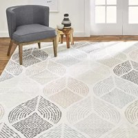 Add mid-century modern style to any room with the New Weave Samira rug collection by Home Dynamix. With a retro-inspired leaf motif, this rug will add an unexpected touch into your décor. Highly designed with polypropylene yarns in a power loomed construction, this rug has soft, plush texture that offers comfort for your bare feet. Durable jute backing adds stability for long-lasting shape and beauty. Stain and fade resistant, this rug is ideal for high traffic areas in the home.