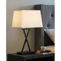 The classic design of crossing lines is updated with a modern technological touch in this Featuring USB charging for your personal devices, this lamp set will add convenience and illumination to any bedside and living areas. Add this great to your home today!