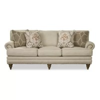 This classic silhouette is generously scaled in length but the seat depth is just a little shorter for those who prefer something less deep. It features plush attached backs with a box border treatment, as well down blend seat cushions so it feels as comfortable as it looks! Handsome nail head trim accents the traditional lawson arm as well as the base. Three unique turned legs on the front and 2 pairs of accent pillows finish the look.