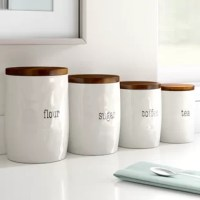 Perfect for both organizing your kitchen counters and letting everyone know where they can find what they're looking for, this labelled set of canisters is a great option for helping you tidy up your space. This set features four containers of various sizes, each with a label for coffee, sugar, and more. Each container is also crafted from lead- and BPA-free ceramic with a white, textured finish that lends them a look equally at home in farmhouse and modern spaces. Included lids cap these jars...