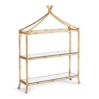 The shelf is a contemporary take on chinoiserie style. Smooth and refined, it is scaled to work well in the smaller space.