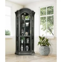 This Corner Display Cabinet features a carved bonnet top cornice. It fits the lifestyle of true american casual. The Cabinet has a reversible back panel. It ships with the self colored Chili Pepper Red Board and Batten back and reverses to a contrasting Chestnut finish on the back side should you desire to change the look. Adjustable glass shelves with Plate Grooves and Halogen Lighting make this cabinet perfect for display.