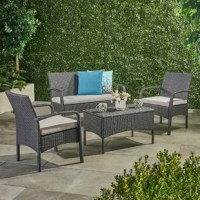 Whether catching some sun and revisiting a favorite well-thumbed novel or casually catching up with close friends over coffee on the patio, this four-piece sofa set is a must-have for your outdoor ensemble. Crafted from an iron frame, each piece features polyethylene wicker that's designed to stand up to sunshine beating down and rainstorms rolling through. Plus, the sofa and two chairs include foam-filled cushions for added comfort, while the coffee table provides a place to perch drinks and...