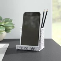 Keep pens and pencils in their place while giving your phone a handy stand with a piece like this one! Crafted from metal, it features a white finish and punched design for a contemporary look on any desktop. Plus, the lower tray is a perfect spot to prop up a smartphone for easy access and viewing. Measuring just 3.5'' H x 3.75'' W x 3.5'' D, this piece is a great addition to most desktops that won't take up too much space.