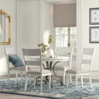 Go from cozy family meals to larger gatherings at a moment's notice with this extendable, rounded dining table. It includes a removable leaf that allows you to seat up to six people for dinner or brunch. Crafted from iron in a pewter hue, this table's open pedestal base features petite turned feet and curved sides for the elegant character. Its tabletop features a paneled design and is finished in a neutral hue that blends in with any color palette. Plus, it arrives with four matching dining...