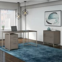 Express your unique style and personality while working hard for years with the commercial-grade Dennehotso Desk 3 Piece Set Whether you're a work from home parent, small business owner or entrepreneur, Dennehotso gives your office the urban appeal of mid century modern styling with a beautiful blend of metal and wood. Constructed of 100% thermally fused laminate, the durable table desk surface resists scratches and stains for a lasting, elegant white or cocoa finish. The titanium finished...