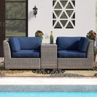 Add a spot to sit to your cozy patio, or add a little extra room to an existing seating area with this three-piece conversation set. It includes two corner sofa pieces, and one side table: The table can be placed between the two chairs, or to the side if you want to arrange the chairs as a loveseat. Each piece is founded atop a rust-resistant, powder-coated aluminum frame, and wrapped in all-weather resin wicker for a classic look. Cushions are included, and feature removable covers that are...