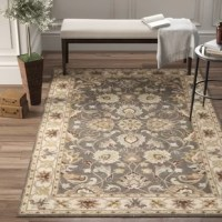 Warming up hardwood and tile floors while setting the stage for the rest of your ensemble, area rugs are essential for nearly any room in your abode. This one, for example, is hand-tufted in India from wool and features a 0.39