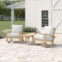 Sit back and sway as you soak up some sun with this three-piece seating group set, complete with two rocking armchairs and one side table. Crafted from solid teak wood, this weather-resistant set sports a natural teak stain for an approachable look. Foam-filled cushions with beige polyester-blend covers top both chairs to provide padding as you relax. Plus, the covers are removable and machine washable for easy upkeep. We recommend you apply protective teak oil periodically to keep this set's...