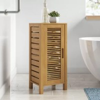 Keep books organized or towels tucked away with the help of this handy storage cabinet. It's crafted from solid wood and showcases a paneled design for a look that's right at home in a variety of design aesthetics from classic to coastal and more. And with a natural wood tone, it's neutral enough to complement nearly any color palette. Inside, it includes three adjustable shelves to help keep clutter under control in your bedroom, master suite, or guest bathroom.