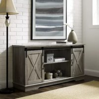 Suited for the modern farmhouse and industrial spaces alike, this TV stand is a versatile pick for the living room. Crafted from manufactured wood, it features a pair of barn-style doors that slide shut for added appeal, while metal hardware completes the aesthetic. Adjustable shelves give you space to set up media players and keep your collection of DVDs on display, and cable management cutouts in the back help you keep your space clutter-free.