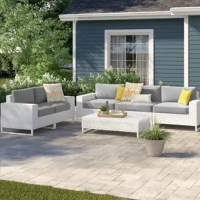 Give your friends and family a spot to relax in your outdoor space with this 6-piece sofa seating group! This set includes two sofas and a coffee table, and each piece in this set is crafted with an aluminum frame with a woven resin wicker exterior for a breezy feel that also resists weather and water. Plus, thanks to its streamlined silhouette, sled legs, and white finish, this set is ideal for a modern look on a patio or deck. Each piece arrives fully assembled and with included cushions, so...
