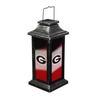 A plastic distressed-metallic finish garden lantern with a sports team twist. Hangable, solar-powered and sun rechargeable (Battery 1 x AA, 300maH, included), the logo printed lantern lights up using the on/off switch at the bottom.