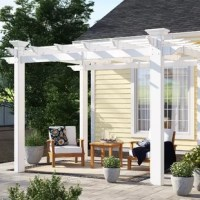 Create a charming and relaxing outdoor space with this 8' square pergola! Crafted from white, weather-resistant vinyl for a classic look that stands up to the elements, it showcases a flat latticed look up top that's perfect for holding climbing flowers and plants or giving your patio a cozy and protected look. Anchors are included, so you can secure it to the ground. To keep this pergola looking it's best, all you need to do is give it the occasional spritz with a hose. Assembly is required.
