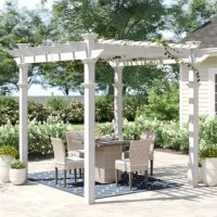 Create a charming and relaxing outdoor space with this 10' square pergola! Crafted from white, weather-resistant vinyl for a classic look that stands up to the elements, it showcases a flat latticed look up top that's perfect for holding climbing flowers and plants or giving your patio a cozy and protected look. To keep this pergola looking it's best, all you need to do is give it the occasional spritz with a hose. Additional materials are required for assembly, depending on where you want to...