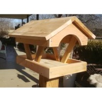 This is a standard fly-through platform feeder that can be loaded with seed, suet cakes, corn or whatever your birds crave.