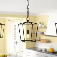 Airy and on-trend, this one-light geometric pendant brings a touch of contemporary style as it boosts the brightness in your space. Crafted from metal, this fixture features an open and angular geometric shade in an understated solid finish for a modern and minimalist feel. A single 40 W medium-base bulb (not included) sits exposed within to cast light in an ambient direction. The manufacturer backs this product with a one-year warranty.