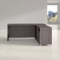 Create the workspace you've been looking for with the help of this executive desk. Made in Canada, it's crafted from manufactured wood and boasts an L-shaped design, so it's perfect for any corner or open office space. Two drawers on metal ball-bearing glides offer space to tuck away office essentials, while an array of shelves provide even more storage space. And as a bonus, it's backed by a 10-year warranty.
