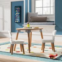 Giving kids a space to create on their own is essential in developing their independence. This table and 2 chairs set have the perfect size for them to explore creativity while coordinating with your own personal design style. This fresh set includes rounded corners, natural-looking wood, and pops of cool color to give a modern update to a classic furniture piece. The curved back chairs provide a comfortable spot for little bodies to sit. The oval table boasts a lift-up lid in the center to...