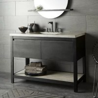 Solid FSC®-certified oak pairs effortlessly with cool concrete to create this transitional bath vanity set. The Solace vanity base features a large open Native Stone® Pearl shelf and two full-extension oak drawers equipped with soft-close glides for ample storage space. This set includes a coordinating Native Stone® Palomar Top with Integral Sink, made from a sustainable blend of concrete and jute fiber, in the same finish as the vanity base's shelf. The top features a rectangular integrated...