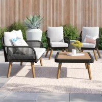 Refresh your patio space with this four-piece conversation set. It includes one coffee table, one loveseat, and two armchairs. All crafted with a steel inner frame, with nylon rope, and solid eucalyptus wood, while the seats are covered with detachable cushions. The 100% polyester cushion covers in white can be removed through a zipper for quick cleaning. This set is great for year-round use. Full assembly is required upon arrival.