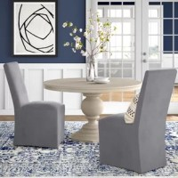 From providing sensible seating arrangements in smaller spaces to rounding out interior designs, accent chairs make all-star additions to any home decor arsenal. Perfect for desks, dining rooms, or sitting areas, this slipcovered, Parsons side chair strikes a traditional silhouette. Crafted from solid wood, it's topped off with linen fabric, and is perfect for neutral and understated ensembles in need of stylish extra seating. Measures 40.5'' H x 20'' W x 27'' D.