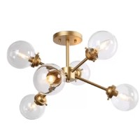 See your home in a whole new light with this semi flush mount. Featuring an iron frame for durable charm, this chandelier has clear glass shades and a painted brass finish for an elegant appeal. This light fixture casts multi-directional illumination, spreading plenty of light over a wide space.