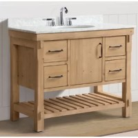 Finalize your bathroom remodel in style with this 42'' W single vanity set. Crafted from solid fir wood and finished in a driftwood look, this piece showcases a traditional look perfect for industrial aesthetics. A slab of white Carrara marble rounds out the piece up top, as well as three pre-drilled holes for a faucet of your choice, and one ceramic under-mount sink. When it comes to storage, this vanity is equipped with four drawers, a cabinet, and an open lower shelf perfect for stacking...