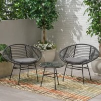 Fashion any patio or deck space with a chic chat set that encourages you to sit back and relax in the great outdoors. Featuring a delightful hand-wrapped look and water-resistant cushion, this chat set provides a timeless style to your home while providing ultimate comfort. Consisting of a steel frame and rattan material, this charming piece is made to last with its weather-resistant construct and durable structure. Sure to become your favorite spot to relax, this set will last you for years to...