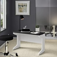 Add a workspace anywhere with the commercial-grade Hythe desk. Whether you need a desk in your home office or an extra workstation in your conference room, the desk's minimalist design will fit effortlessly. It has a wide desktop, creating a larger work surface, slim shaped side panels for easy leg movement and a wire management trough and slots to keep cords organized. The subtle curves and beautiful finish also give the desk a refined elegance that'll enhance the style of any room. When...
