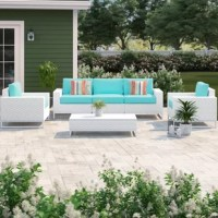 Create the perfect outdoor oasis with this 6-piece sectional seating set! Including a sofa, two armchairs, and a coffee table, this set's showcases sled legs, a white finish, and streamlined silhouettes that lend it a contemporary feel in your outdoor ensemble. Each piece in this set is crafted with an aluminum frame that's wrapped in resin wicker that makes them both UV- and weather-resistant. Plus, thanks to the included cushions, you can get right to relaxing as soon as this set arrives....